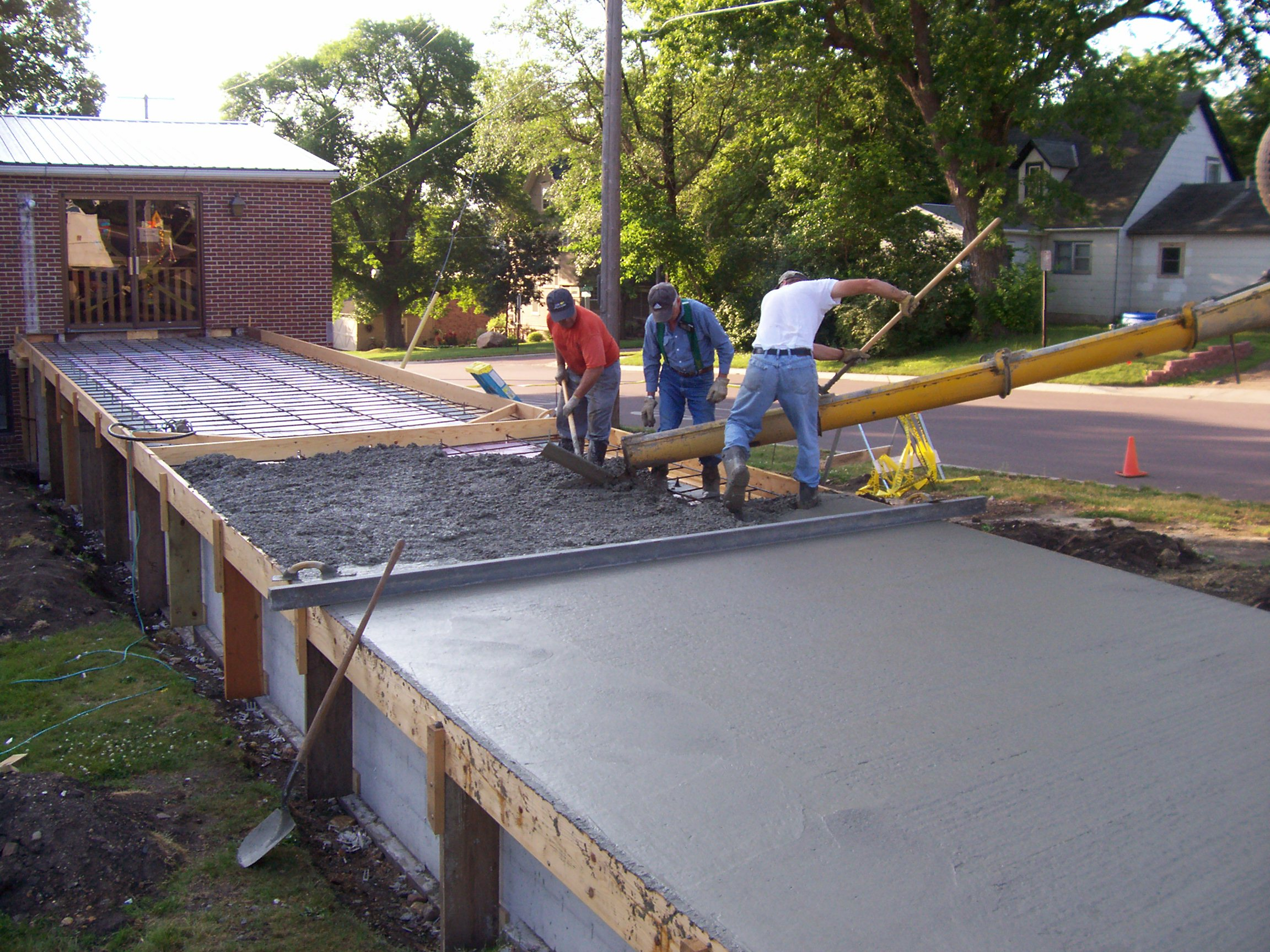 Ramp update pouring cement the heart of a pastor for Pouring concrete driveway